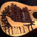 My guitar with permanent marker wolf and forest